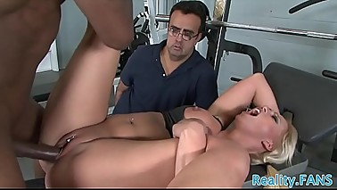Busty babe cuckolds her husband in the gym